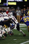 New England Patriots running back Sony Michel (26) in action during the NFL Super Bowl 53 football game against the Los Angeles Rams on Sunday, Feb. 3, 2019, in Atlanta. The Patriots defeated the Rams 13-3. (©Paul Anthony Spinelli)