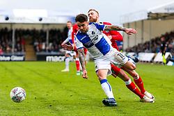 Dom Telford of Bristol Rovers is challenged by Scott Wagstaff of Gillingham - Rogan/JMP - 28/04/2018 - FOOTBALL - Memorial Stadium - Bristol, England - Bristol Rovers v Gillingham - EFL Sky Bet League One.