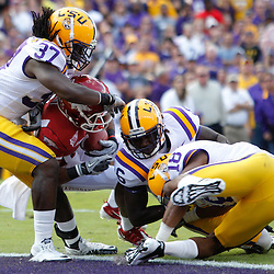 November 25, 2011; Baton Rouge, LA, USA;  Arkansas Razorbacks wide receiver Jarius Wright (4) crosses the goal line for a touchdown against the LSU Tigers a during the second quarter of a game at Tiger Stadium.  Mandatory Credit: Derick E. Hingle-US PRESSWIRE