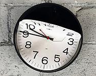 Broken wall clock. Concept photo of time.