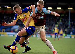 Southampton's James Ward-Prowse (left) and Burnley's Charlie Taylor battle for the ball