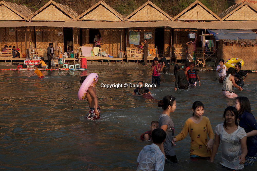 The bathing area fills with people from early on. Shwet Set Taw, Magwai Division, Myanmar. February 2014.