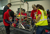 "The Gilford ""Screaming Eagles"" team check over their robot before qualifying rounds during the Governor's Cup FirstNH Robotics Competition at All Well North/PSU on Saturday.  (Karen Bobotas/for the Laconia Daily Sun)"