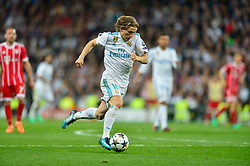 May 2, 2018 - Madrid, Spain - MADRID, SPAIN. May 1, 2018 - Luka Modric with the ball. With a 2-2 draw against Bayern Munchen, Real Madrid made it to the UEFA Champions League Final for third time in a row. Kimmich and James scored for the german squad while Karim Benzema did it twice for los blancos. Goalkeeper Keylor Navas had a great night with several decisive interventions. (Credit Image: © VW Pics via ZUMA Wire)