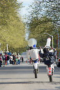 """Baltimore, Maryland - April 21, 2015: Men on dirtbikes strike the """"12 o'clock"""" position during a vigil-turned-protest march for the death of Freddie Gray who was injured while detained by police, and died from his injuries Sunday. His spinal cord was 80% severed.<br /> <br /> CREDIT: Matt Roth for The New York Times<br /> Assignment ID: 30173645A"""