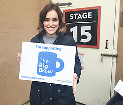 "© Licensed to London News Pictures . 19/01/2015 . Liverpool , UK . Elizabeth Henstridge from Agents of Shield . Celebrities pose with "" Big Brew "" placards in support of mental health awareness as today (19th January 2015) marks "" Blue Monday "" , the day regarded by many as the most depressing in the year . Campaigners are urging the public to show support by tweeting sefies with their favourite brew and the hashtag "" #brewfie "" . In London , Deputy Prime Minister Nick Clegg , is announcing his campaign to improve mental health awareness , reduce stigma and promote a "" zero ambition "" target for suicide . Photo credit : Joel Goodman/LNP"