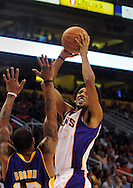 Oct. 29 2010; Phoenix, AZ, USA; Phoenix Suns guard Josh Childress (1) puts up a shot against Los Angeles Lakers guard-forward Shannon Brown (12) during the first half at the US Airways Center. The Lakers defeated the Suns 114-106.  Mandatory Credit: Jennifer Stewart-US PRESSWIRE.