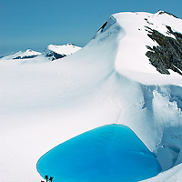 Hikers stop at a glacier bool on a hike across Baranof island from Sitka to Baranof Warm Springs