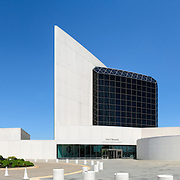 Panorama of the entrance side of the John F. Kennedy Presidential Library and Museum on the waterfront in Dorchester in Boston, Massachusetts. Dedicated to the 35th president of the United States, the JFK Library is the official National Archves and Records Administration repository of the presidential records of John F. Kennedy.