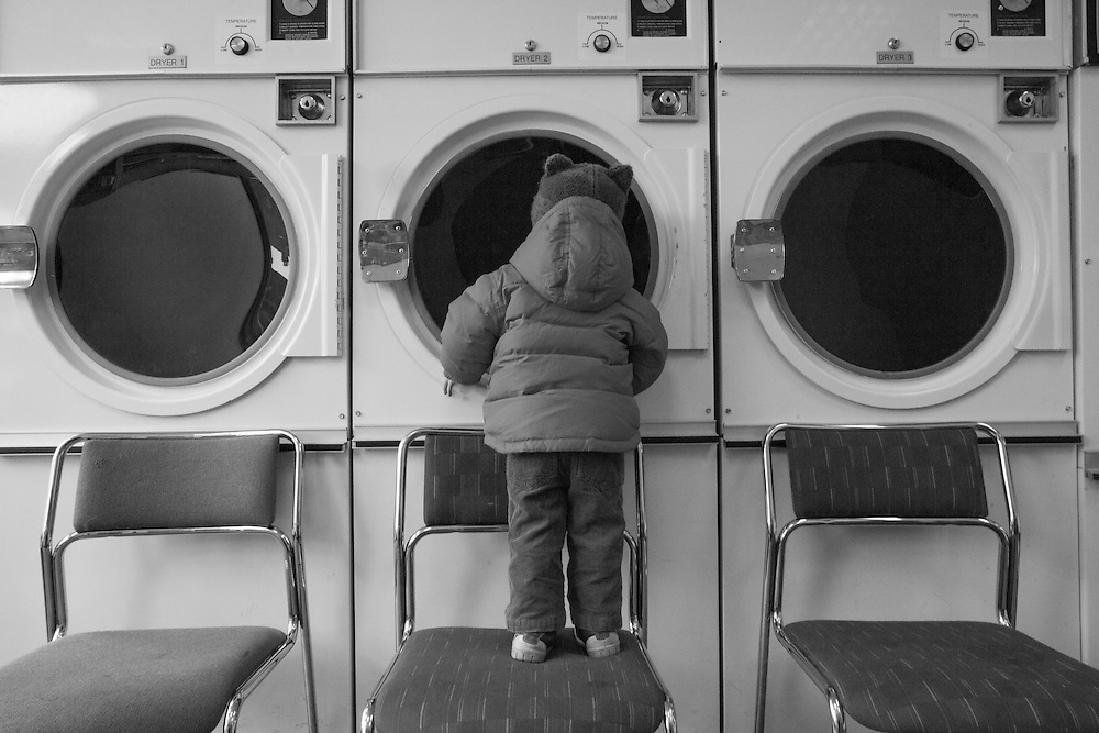 Joe looks in to the washers at the dry cleaners in Berkhamsted, England Thursday, Feb. 5, 2015 (Elizabeth Dalziel) #thesecretlifeofmothers #bringinguptheboys #dailylife