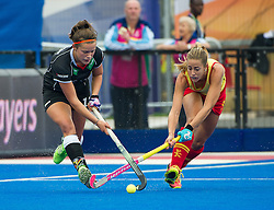 Germany's Charlotte Stapenhorst is tackled by Maria Lopez of Spain. Germany v Spain - 3rd/4th Playoff Unibet EuroHockey Championships, Lee Valley Hockey & Tennis Centre, London, UK on 30 August 2015. Photo: Simon Parker