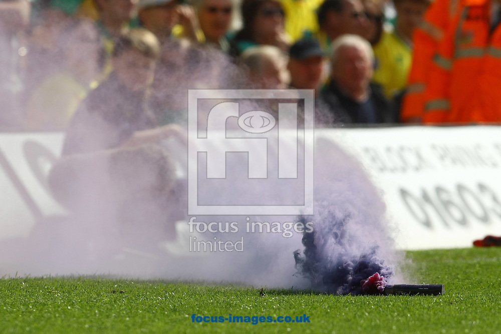 Picture by Paul Chesterton/Focus Images Ltd.  07904 640267.13/05/12.A flare thrown onto the pitch by the Aston Villa fans during the Barclays Premier League match at Carrow Road Stadium, Norwich.
