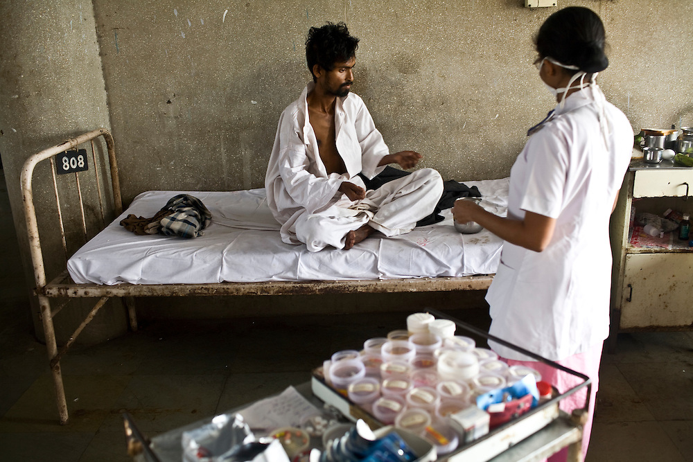 A nurse at the Group of TB Hospitals in Mumbai dispenses daily TB medicine.