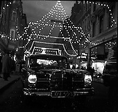 1960 - Mercedes car under Christmas lights on Grafton Street