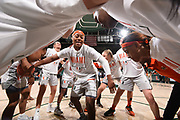 January 20, 2019: Taylor Mason #13 of Miami (center) motivates teammates Laura Cornelius #1 (left) and Emese Hof #21 and Rebecca Ripley #23 (right) before the NCAA basketball game between the Miami Hurricanes and the North Carolina Tar Heels in Coral Gables, Florida. The 'Canes defeated the Tar Heels 76-68.