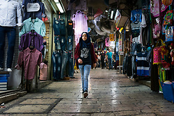A girl walks through the Old City, Jerusalem.