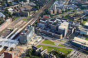 Nederland, Zuid-Holland, Leiden, 15-07-2012; station en stationsgebied Leiden centraal, rechts Leids Universitair Medisch Centrum LUMC..Railway station district of Leiden with University hospital and old town in the back (l)..luchtfoto (toeslag), aerial photo (additional fee required).foto/photo Siebe Swart