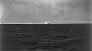 The iceberg that sank the White Star Line's Olympic-class RMS Titanic which struck it on 12 April 1912 on her maiden voyage from Liverpool to New York with loss of over 1,500 lives. View from SS Carpathia which picked up survivors.