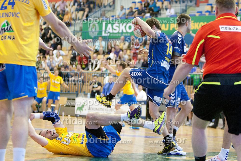 Alem Toskic of Celje PL and Sebastian Skube of Cimos during handball match between RK Celje Pivovarna Lasko vs RK Cimos Koper in 9th Round of 1st NLB Leasing Champions league 2011/12, on May 19, 2012 in Arena Zlatorog, Celje, Slovenia. (Photo by Urban Urbanc / Sportida.com)