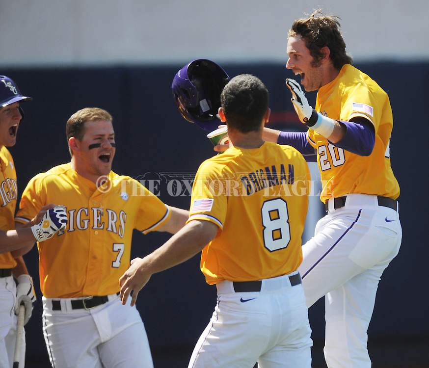 LSU's Conner Hale (20) is congratulated by teammates Andrew Stevenson, left, Sean McMullen (7) and Alex Bregman (8) following his 8th inning solo home run against Mississippi at Oxford-University Stadium in Oxford, Miss. on Saturday, April 19, 2014. (AP Photo/Oxford Eagle, Bruce Newman)