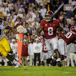 Nov 3, 2018; Baton Rouge, LA, USA; Alabama Crimson Tide running back Josh Jacobs (8) runs as LSU Tigers defensive end Rashard Lawrence (90) pursues during the first quarter at Tiger Stadium. Mandatory Credit: Derick E. Hingle-USA TODAY Sports