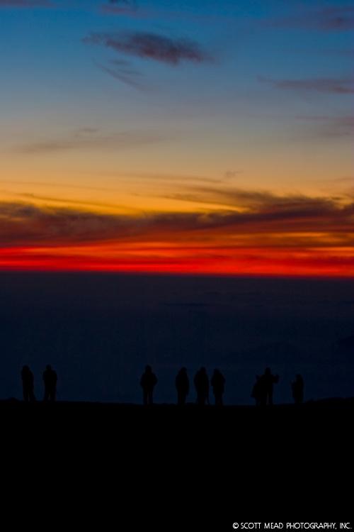 Sunrise atop Haleakala, silhouette people at crater, Maui, Hawaii