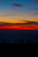 Sunrise atop Haleakala, silhouette people at crater, Maui, Hawaii