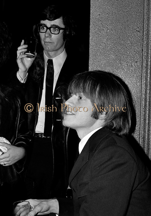 .The Rolling Stones Charlie is my Darling - Ireland 1965 - Brian Jones relaxing at the Rolling Stones press conference at the Adelphi Theatre, Middle Abbey Street, Dublin. This was the band's first Irish tour of 1965....07/01/1965.01/07/1965.07 January 1965..The Rolling Stones Charlie is my Darling - Ireland 1965.Out November 2nd from ABKCO.Super Deluxe Box Set/Blu-ray and DVD Details Revealed. .ABKCO Films is proud to join in the celebration of the Rolling Stones 50th Anniversary by announcing exclusive details of the release of the legendary, but never before officially released film, The Rolling Stones Charlie is my Darling - Ireland 1965.  The film marked the cinematic debut of the band, and will be released in Super Deluxe Box Set, Blu-ray and DVD configurations on November 2nd (5th in UK & 6th in North America).. .The Rolling Stones Charlie is my Darling - Ireland 1965 was shot on a quick weekend tour of Ireland just weeks after ?(I Can't Get No) Satisfaction? hit # 1 on the charts and became the international anthem for an entire generation.  Charlie is my Darling is an intimate, behind-the-scenes diary of life on the road with the young Rolling Stones featuring the first professionally filmed concert performances of the band's long and storied touring career, documenting the early frenzy of their fans and the riots their live performances incited.. .Charlie is my Darling showcases dramatic concert footage - including electrifying performances of ?The Last Time,? ?Time Is On My Side? and the first ever concert performance of the Stones counterculture classic, ?(I Can't Get No) Satisfaction.?  Candid, off-the-cuff interviews are juxtaposed with revealing, comical scenes of the band goofing around with each other. It's also an insider's glimpse into the band's developing musical style by blending blues, R&B and rock-n-roll riffs, and the film captures the spark about to combust into The Greatest Rock and Roll Band in the World.. .The 1965 version of Charlie is