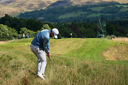 Gleneagles, Scotland, UK; 9 August, 2018.  Day two of European Championships 2018 competition at Gleneagles. Men's and Women's Team Championships Round Robin Group Stage - 2nd Round. Four Ball Match Play format. Liam Johnstone of team GB  plays out of the rough