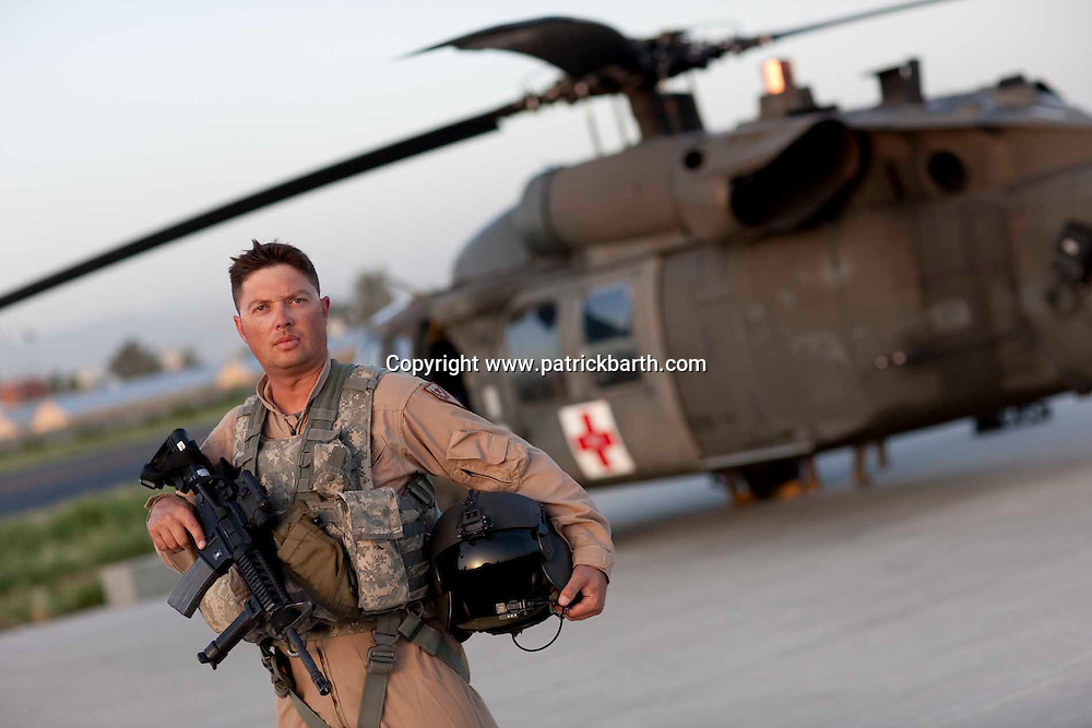 CW2 Medevac Pilot Jason Penrod: Because of dangers around here there are few areas we go without an Apache attack helicopter escort. And that is for a reason.  There are people here who shoot at us but you don'y fly your aircraft any different. I don't want to be the guy on Al Jazeera who has crashed just because I did something stupid. My biggest fear is injuring one of my crew or damaging the aircraft. I don't talk a lot about what I do to my family. I just got married before I came out here and it has been a tough pill for my family to swallow. We have all had sleepless nights here after some of the missions we fly. But being here makes you look at a lot of things a lot differently.