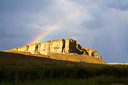 Rainbow over ranchland butte - Central Colorado.