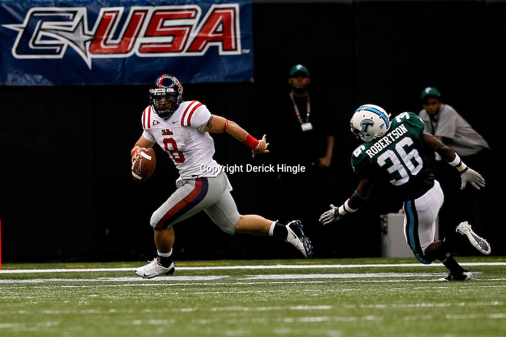Sep 11, 2010; New Orleans, LA, USA; Mississippi Rebels quarterback Jeremiah Masoli (8) runs from Tulane Green Wave linebacker Dominique Robertson (36) during a game at the Louisiana Superdome. The Mississippi Rebels defeated the Tulane Green Wave 27-13.  Mandatory Credit: Derick E. Hingle
