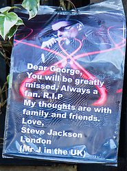 Highgate, London, December 26th 2016. Fans gather outside the London home of pop icon George Michael who died on Christmas day. PICTURED: A Fan's poster attached to the railings outside George Michael's London home.