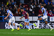 Ryan Fredericks of West Ham United (24) looks to take on Eric Durm of Huddersfield Town (37) and Philip Billing of Huddersfield Town (8) during the Premier League match between Huddersfield Town and West Ham United at the John Smiths Stadium, Huddersfield, England on 10 November 2018.
