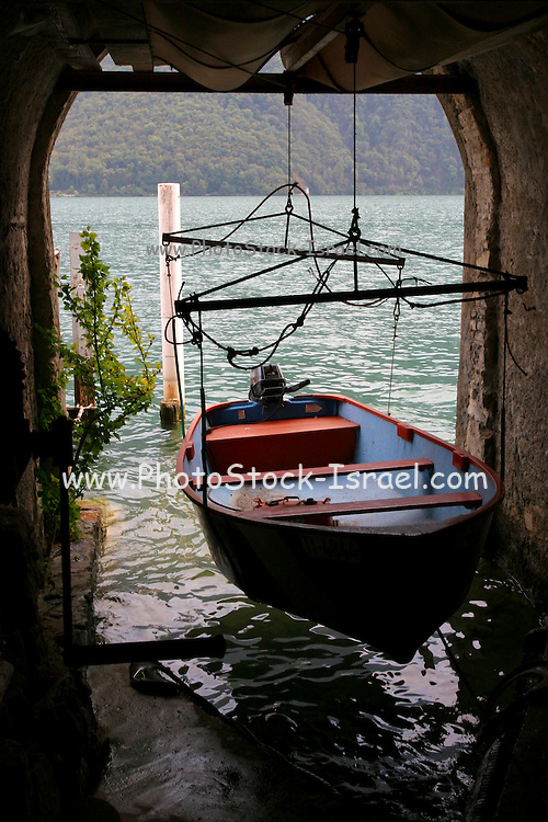 Switzerland, Ticino, Lugano, The dinghy of one of Gandria residents, small village near the city Lugano. The fastes way between this village and the city is by crossing the lake