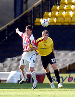 Photo: Leigh Quinnell.<br /> Watford v Sheffield United. Coca Cola Championship.<br /> 17/09/2005. Sheffield Uniteds Chris Morgan jumps for the ball with Watfords Darius Henderson.