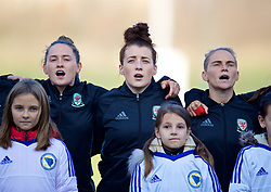 ZENICA, BOSNIA AND HERZEGOVINA - Tuesday, November 28, 2017: Wales' Rachel Rowe, Angharad James and Jessica Fishlock stand to sing the national anthem before the FIFA Women's World Cup 2019 Qualifying Round Group 1 match between Bosnia and Herzegovina and Wales at the FF BH Football Training Centre. (Pic by David Rawcliffe/Propaganda)