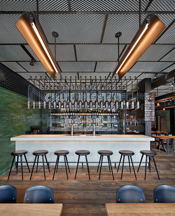 Rick Bayless' restaurant Leña Brava and brewery Cruz Blanca in Chicago. Designed by Design Bureaux with lighting by Dot Dash. Photographs by John Muggenborg.