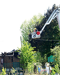 Fire fighters use a lift to view the damage caused by a fire in the Islamic center, Muswell Hill, London. The fire is reported to be from a far right organisation.<br /> United Kingdom<br /> Wednesday, 5th June 2013<br /> Picture by Max Nash / i-Images