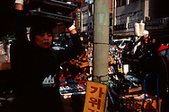 Woman delivering food at busy street scene, Dongdaemun market complex, Seoul