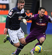 Picture by David Horn/Focus Images Ltd +44 7545 970036.16/02/2013.James Henry of Millwall rounds Mark Tyler of Luton Town to score his side's first goal during the The FA Cup match at Kenilworth Road, Luton.