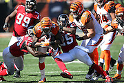 Cincinnati Bengals running back Jeremy Hill (32) gets gang tackled by Atlanta Falcons linebacker Prince Shembo (53) and Atlanta Falcons strong safety William Moore (25) as he runs the ball in the fourth quarter during the NFL week 2 regular season football game against the Atlanta Falcons on Sunday, Sept. 14, 2014 in Cincinnati. The Bengals won the game 24-10. ©Paul Anthony Spinelli