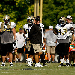 August 1, 2010; Metairie, LA, USA; New Orleans Saints head coach Sean Payton watches his team during a training camp practice at the New Orleans Saints practice facility. Mandatory Credit: Derick E. Hingle