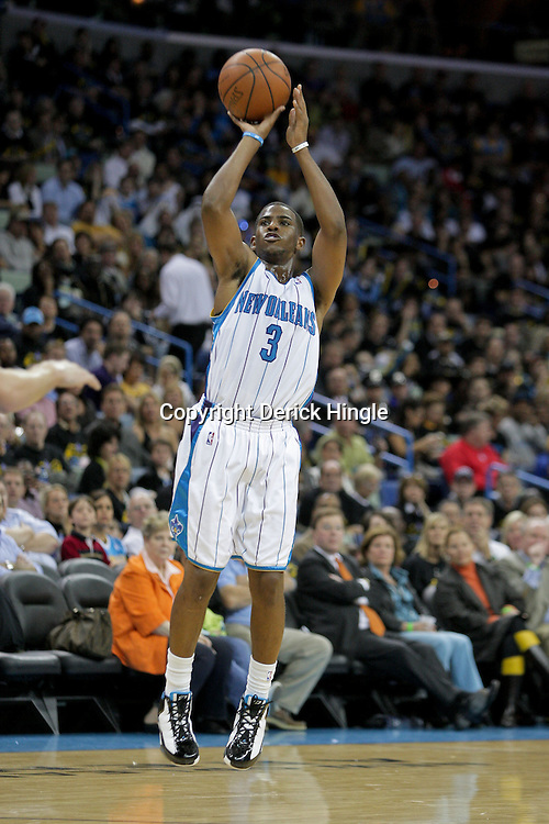 Oct 30, 2009; New Orleans, LA, USA;  New Orleans Hornets guard Chris Paul (3) shoots a three pointer in the fourth quarter against the Sacramento Kings at the New Orleans Arena. The Hornets defeated the Kings 97-92. Mandatory Credit: Derick E. Hingle-US PRESSWIRE