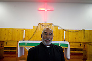 MANENBERG, SOUTH AFRICA - SEPTEMBER 15: Rev. Donovan Meyer of The Parish of Reconciliation Anglican Church stands for a portrait after Sunday morning services on September 15, 2013 in Manenberg, a township of Cape Town, South Africa. In August, 16 schools were closed in the area due to increasing gang violence. Rev. Donovan took part in the brokering of an uncertain peace between the gangs to help the community resume their daily lives. Photo by Ann Hermes/The Christian Science Monitor