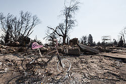 October 13, 2017 - Santa Rosa, California, U.S. - A lone bicycle stands where it was left when the owners of this home had to flee, in the middle of the night, as the Tubbs Fire jumped Hwy 101 and turned the Coffey Park neighborhood, in Santa Rosa California into an inferno. (Credit Image: © Rustin Gudim/ZUMA Wire/ZUMAPRESS.com)
