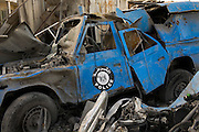 A damaged Palestinain police wagon lies amid the rubble of the Rafah Police headquarters complex, in Rafah, Gaza January 15, 2009. In the 20 days since the Israeli assault of Gaza, the Israeli Defense Forces have significantly targeted Palestinian infrastructure and civil authorities including the police force which was under the control of HAMAS.  Photo by Scott Nelson/World Picture Network for the New York Times.