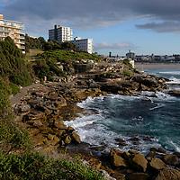 Sunrise on Bondi Beach and the Bondi to Bronte Coastal walk path in Sydney, Australia.