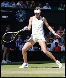 Image ©Licensed to i-Images Picture Agency. 03/07/2014. London, United Kingdom. Eugenie Bouchard playing Simona Halep in the ladies semi final at Wimbledon. Picture by Andrew Parsons / i-Images
