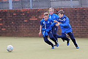 Young Rochdale supporters play 5 a-side pre-match during the EFL Sky Bet League 1 match between Rochdale and Gillingham at Spotland, Rochdale, England on 23 September 2017. Photo by Daniel Youngs.
